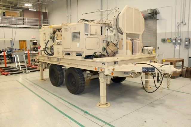 """IBCS Integrated Fire Control Network relays, Engagement Center trailers and Engagement Operations Centers operated by soldiers in the U.S. Army's 2020 Limited User Test are lined up after their """"refresh"""" at the Northrop Grumman Huntsville (Ala.) Manufacturing Center for return to the Army."""